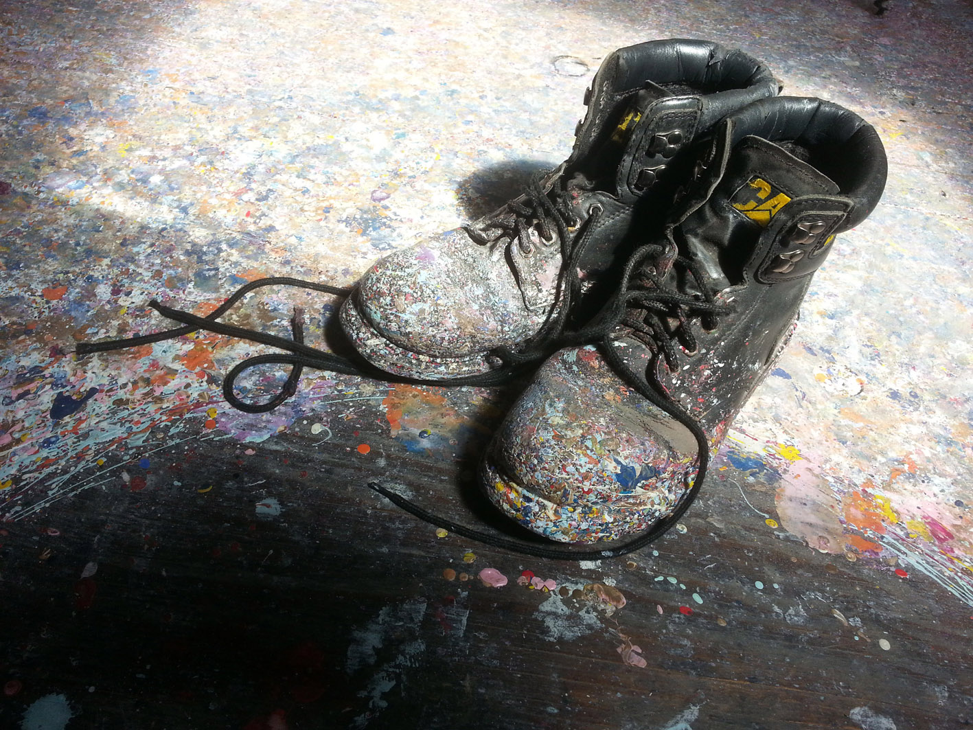 pic of paint spattered boots as worn by alan dedman