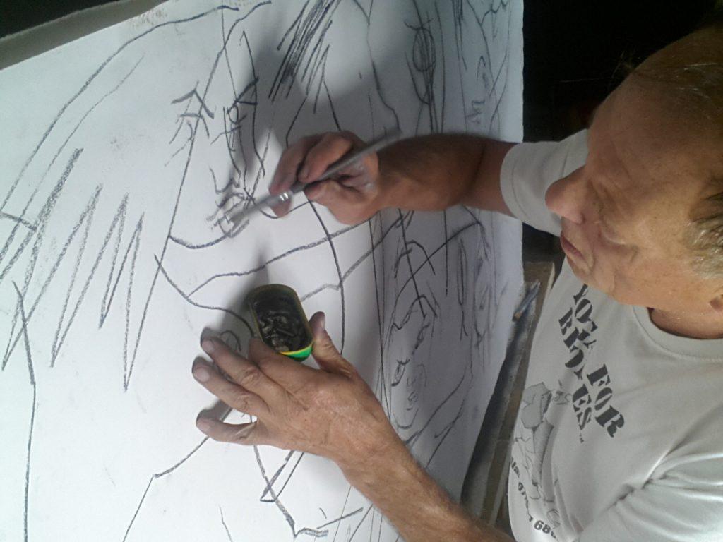 Alan Dedman pouncing charcoal through a cartoon Les Dems