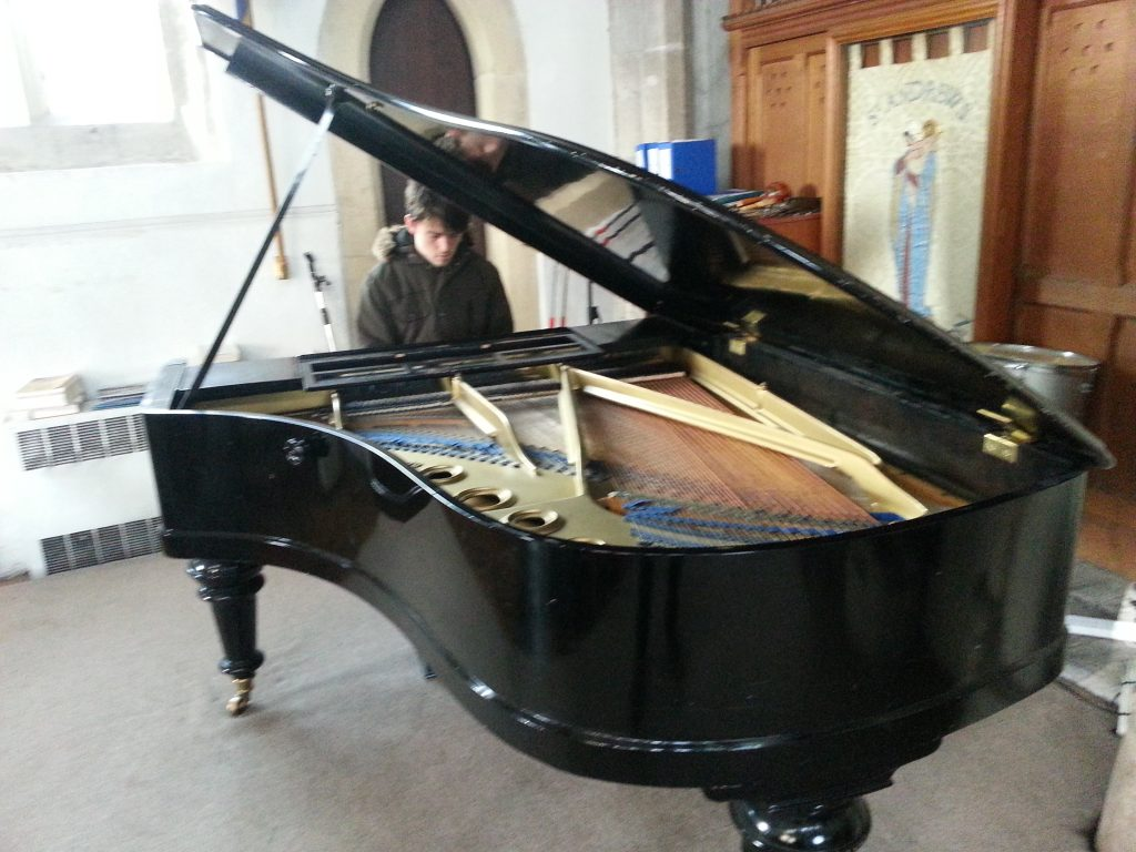 Picture of grand piano being played by max dedman in st andrews church alan dedman basil george dedman obituary