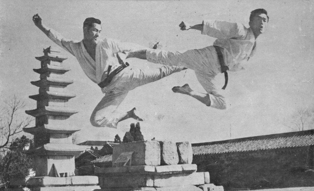 black & white pic of flying kicks in taekwon-do
